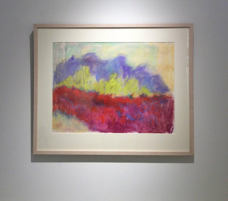 19 x 25 inches, pastel on archival paper 27 x 33 x 1.5 inches framed, custom white stained wooden frame with white mat and glass  This brilliantly colored abstract landscape pastel drawing on paper is inspired by the Red Clover Fields that are near