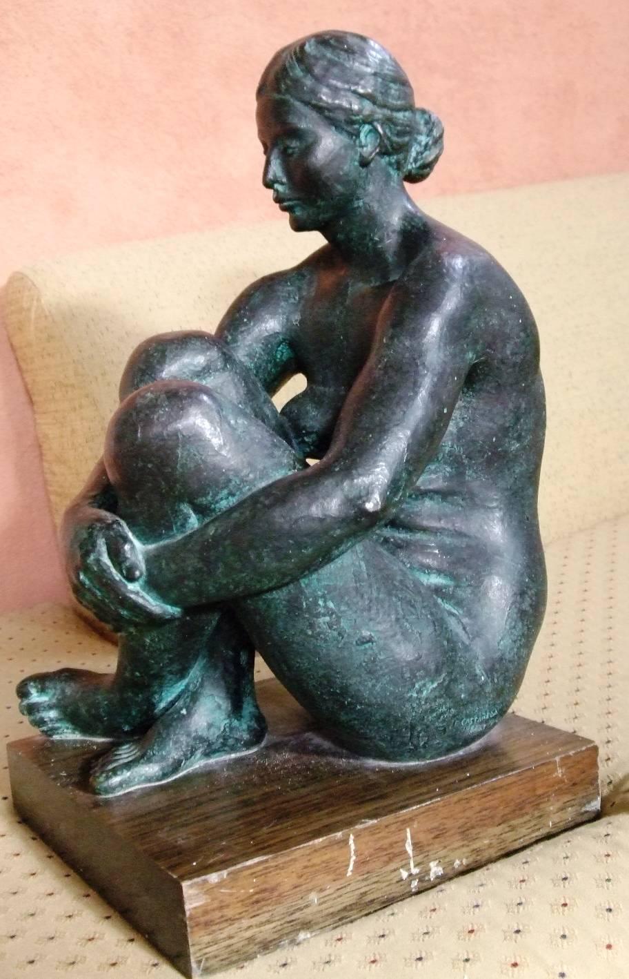 Desnudo Sentada