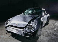 NINE-ONE-ONE (Porsche 911) - large scale studio photograph of crashed automobile