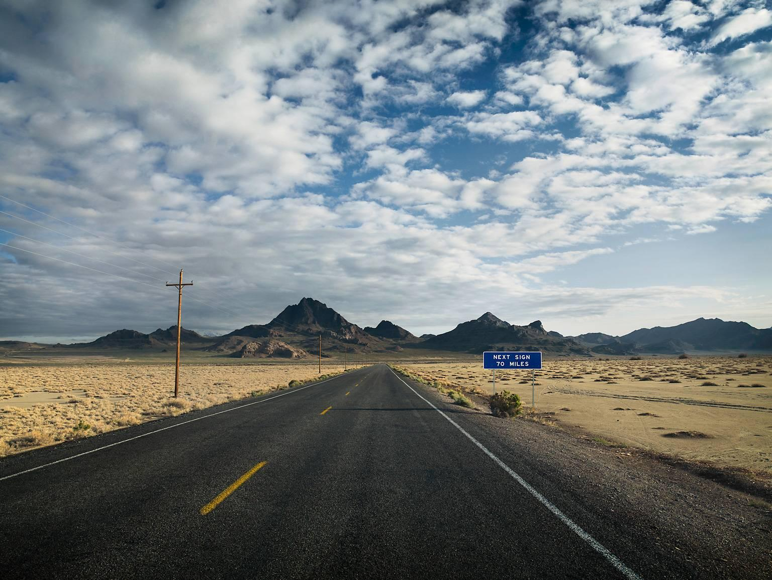 Next Sign - large format landscape photograph with conceptual road sign