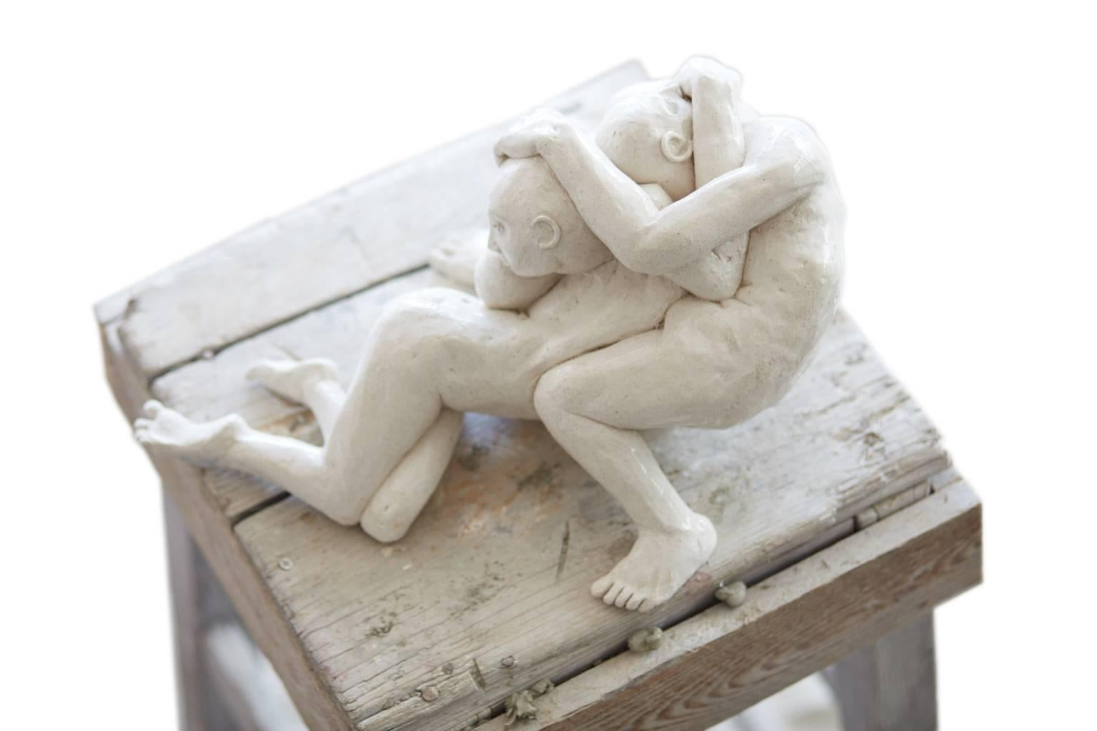 Pieta II - contemporary interpretation of iconic embrace tabletop sculpture