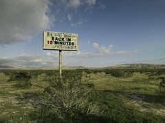 Back in 10 - large format photograph of conceptual message sign in landscape