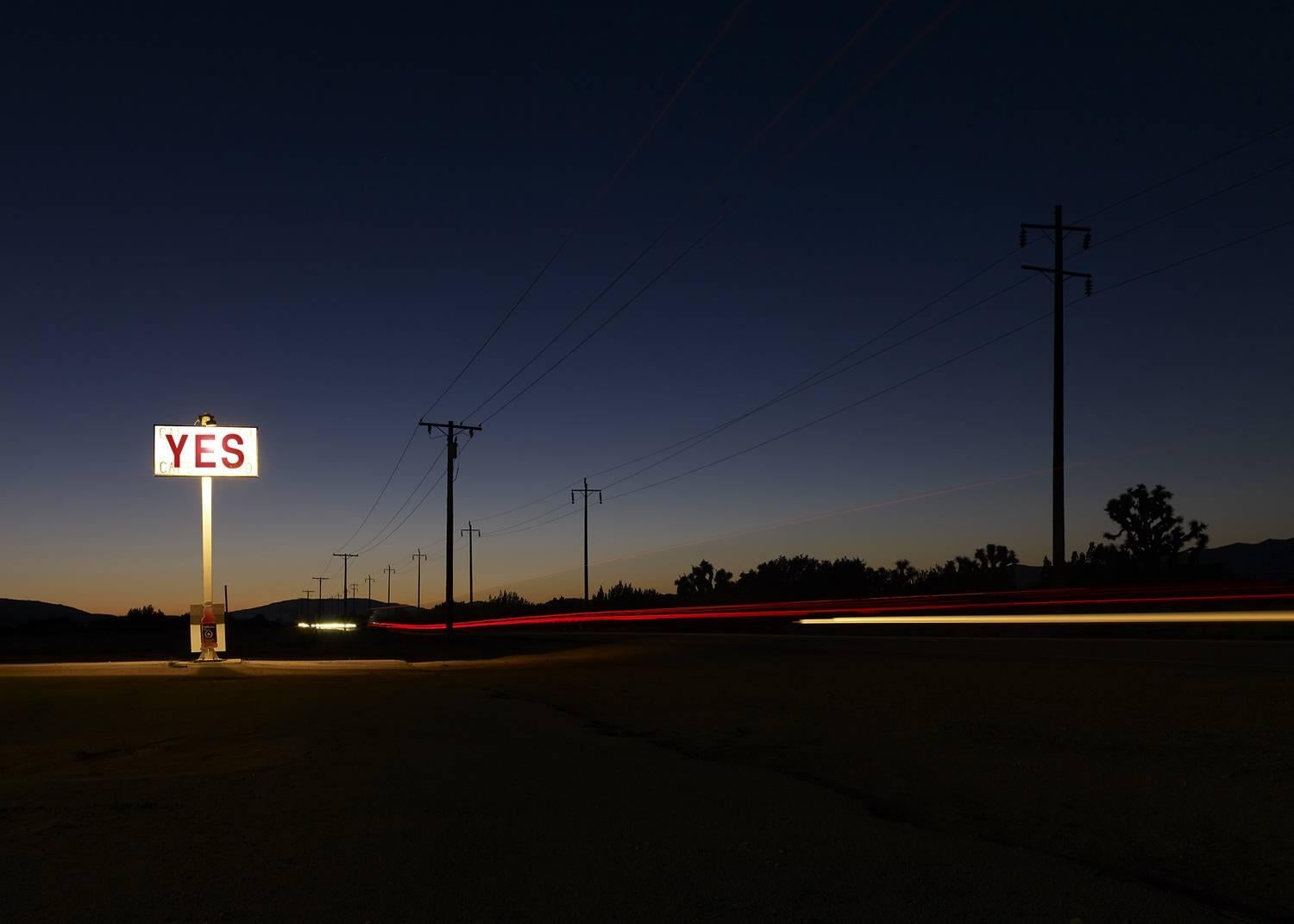 YES - large format photograph of conceptual motivational sign at night