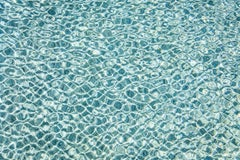 H2O-l large format photograph of sun reflections on pool water surface