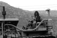 Frank Zappa on tractor B&W