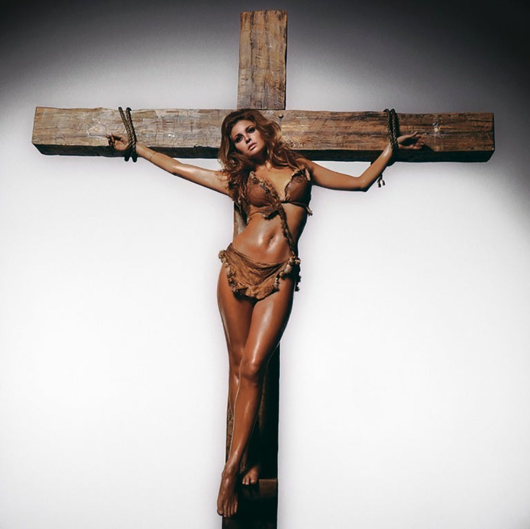 Terry O'Neill Color Photograph - Raquel Welch On The Cross (Colour)