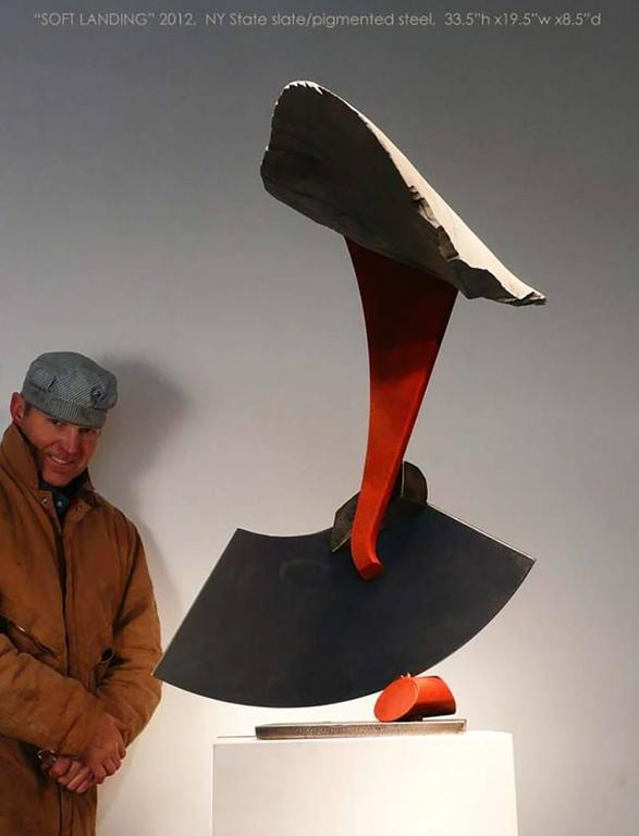 slate/pigmented and sealed steel  Stone and metal, usually granite or slate and found object steel are central in my sculpture. The interaction of these materials is a major focus. On the most basic level the work is about the marriage of the