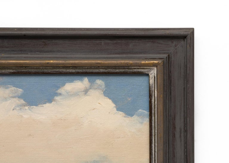 An original oil painting of Southern California by Jon Blanchette portraying a sturdy white barn and surrounding buildings against a cloud scattered blue sky. Presented in a custom frame, outer dimensions measure 31 x 27 x 1 ¼ inches.  Image size is
