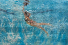 BACK TO THE SURFACE, woman swimming underwater, photo-realism, blue, light