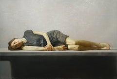 SLIVER, portrait, woman lying on table, grey background, dark grey dress