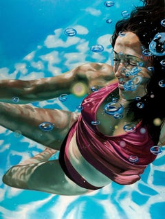 UNBOUND, women underwater, red bikini, blue water, bubbles, light in water
