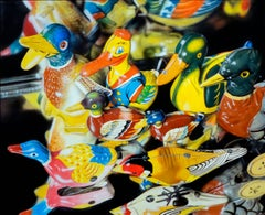 EIGHT TIN BIRDS, toy ducks, multi-colored, yellow, hyper-realism, bright, vivid