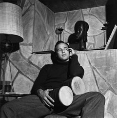 Marlon Brando with bongo drums at his Beverly Hills home