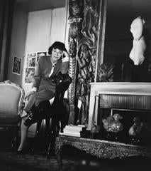 Coco Chanel Leaning on Chair in her Apartment, Paris