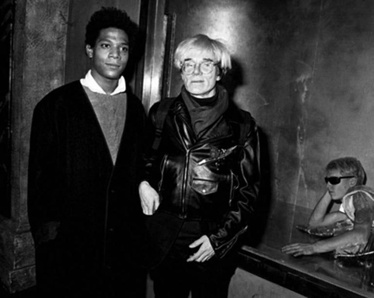 Ron Galella Black and White Photograph - Andy Warhol and Jean-Michel Basquiat at Area, New York