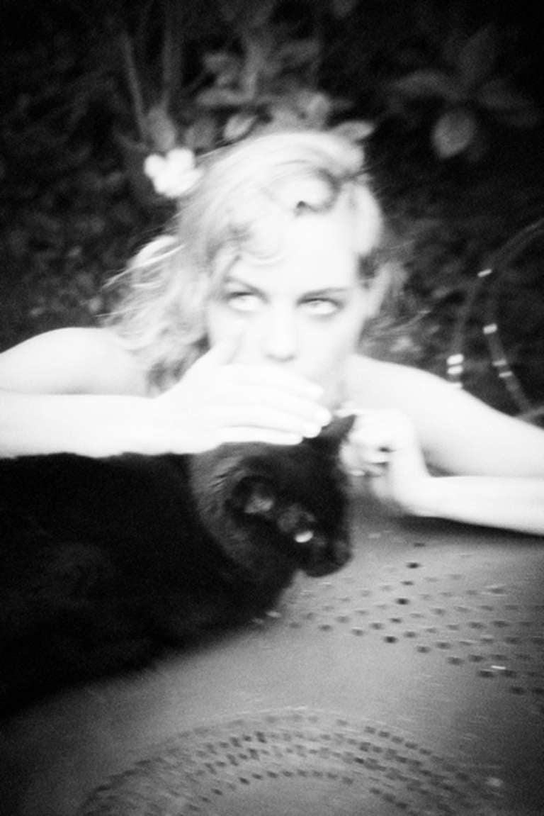 Ellen von Unwerth Black and White Photograph - Cat Whisperer