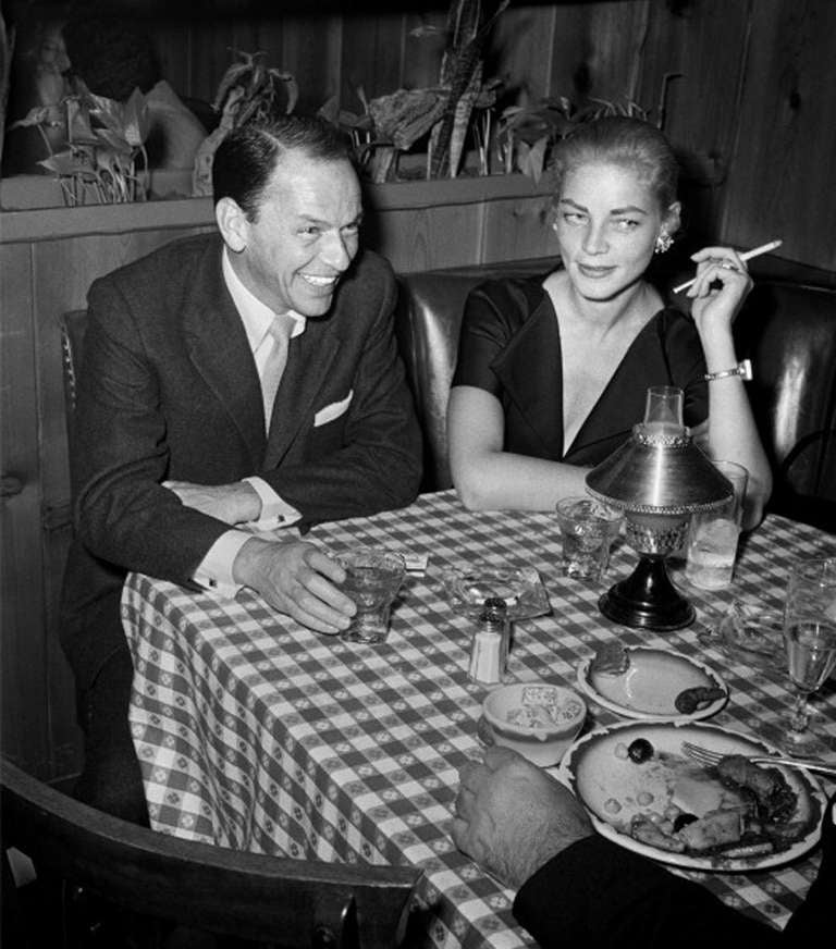 Frank Worth Black and White Photograph - Frank Sinatra and Lauren Bacall at Musso & Frank Grill, 1957