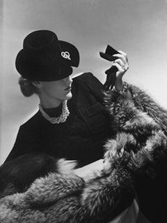 Model in black holding glove