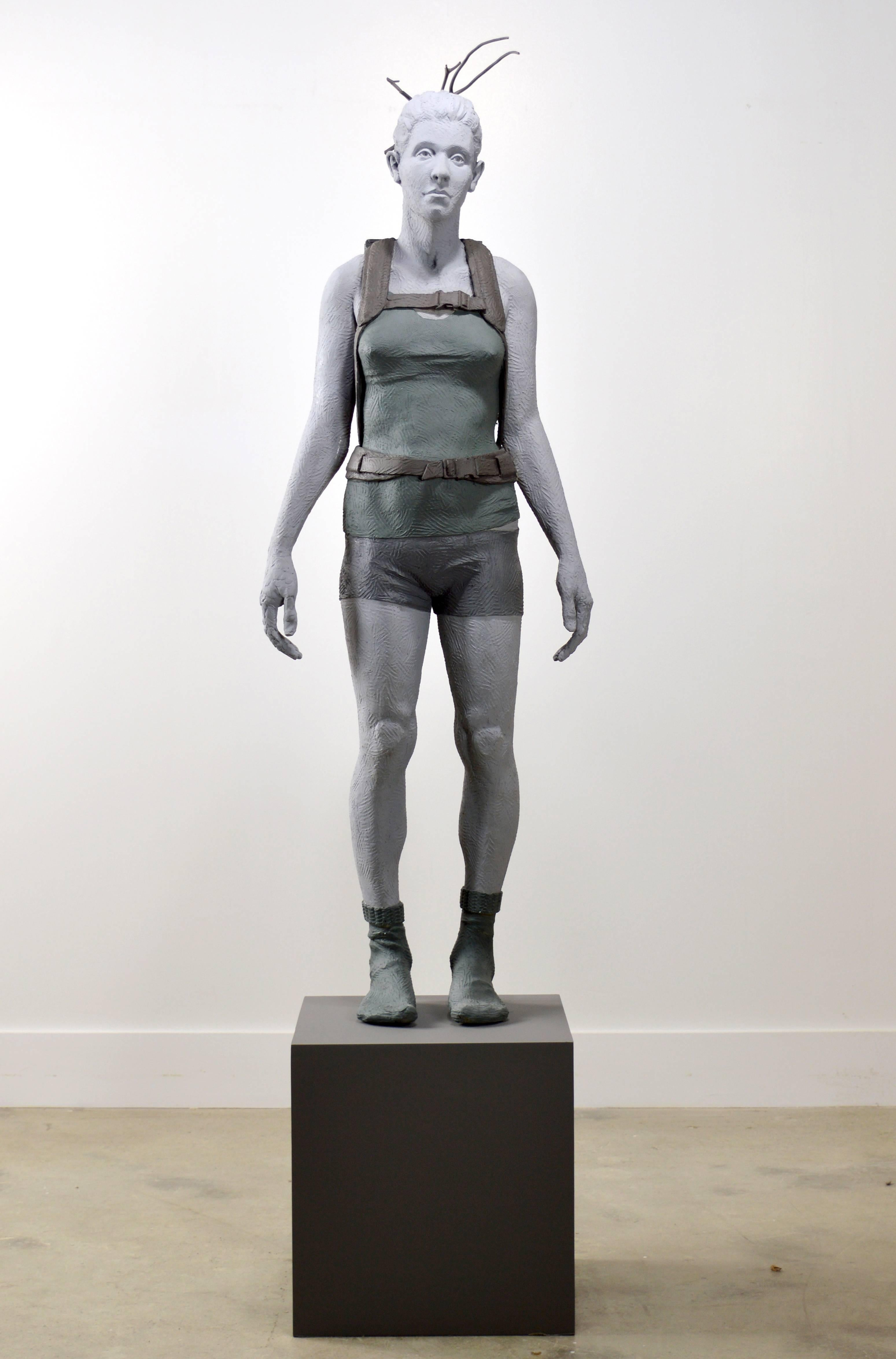 Girl With Crate 1 of 3 - tall, figurative, female, muted colour, resin sculpture