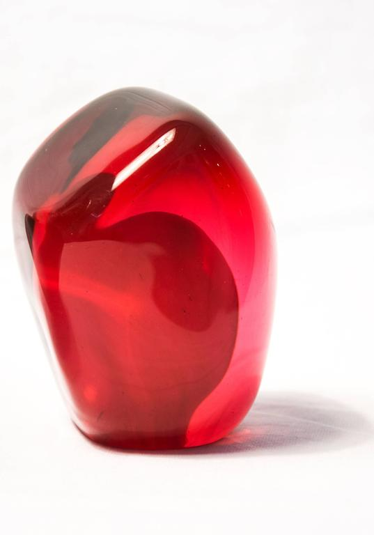 A grouping of luscious pomegranate red glass and one single seed. Skilfully executed in blown glass - the inner element opaque, the outer translucent. Works from this series were recently selected to be exhibited at the prestigious international
