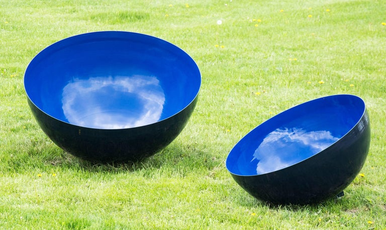 A stainless steel bowl is coated in a brilliant ultramarine blue in this outdoor installation by sculptor Marlene Hilton Moore.  The artist has used UV resistant aerospace paint.  Based on Tibetan singing bowls, this large scale version may be rung