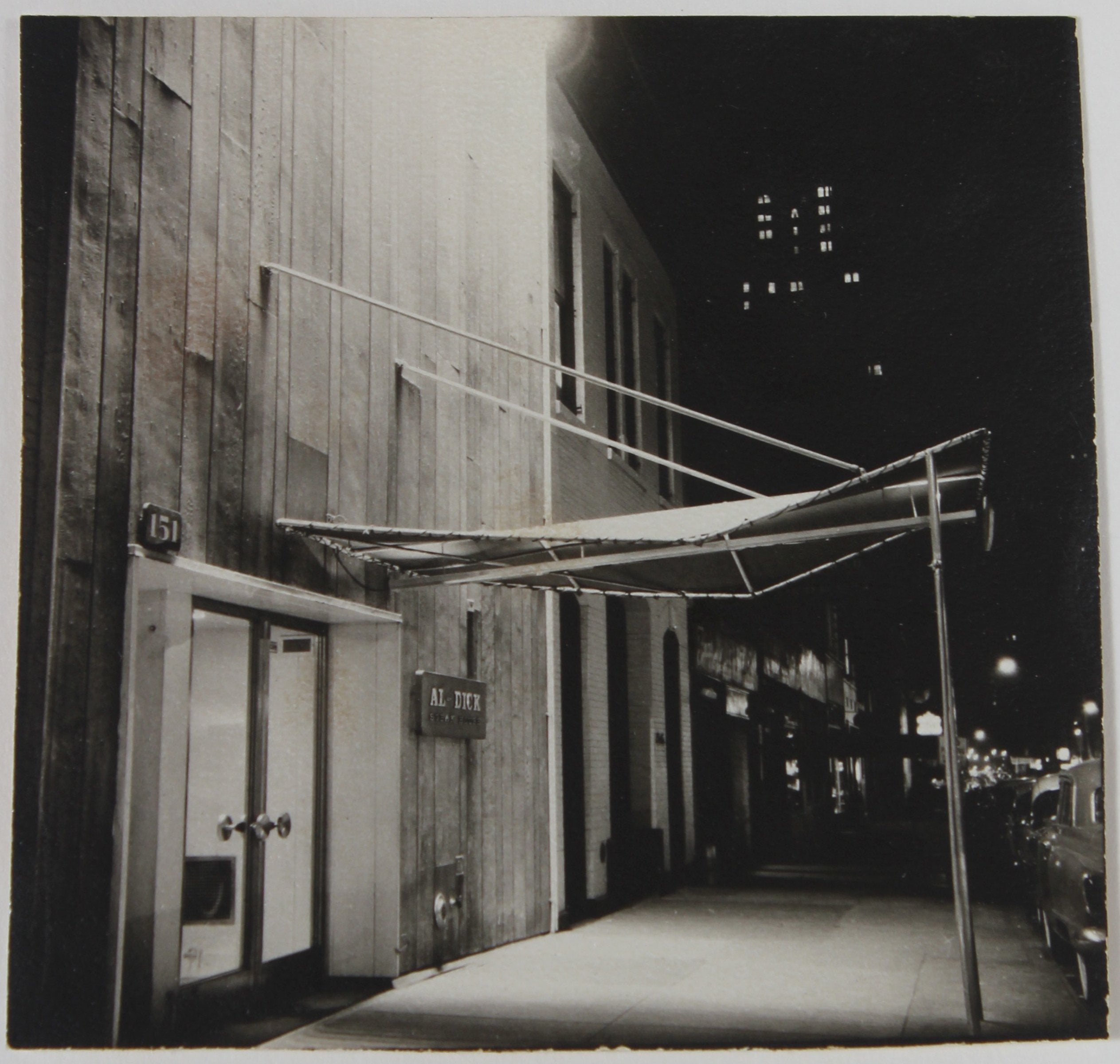 City Street at Night 1960s Black and White Photograph