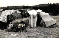 Woodstock (girl with hay bales)