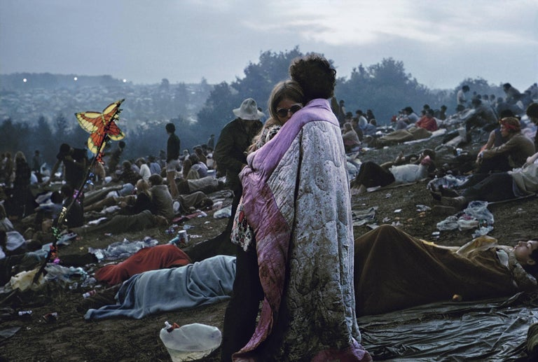 In 1969, Nick and Bobbi Ercoline were immortalized when Burk Uzzle captured this image of them, wrapped in a tattered quilt, amidst the weary crowds at the Woodstock Music Festival. This iconic image was later used for the cover of the Woodstock
