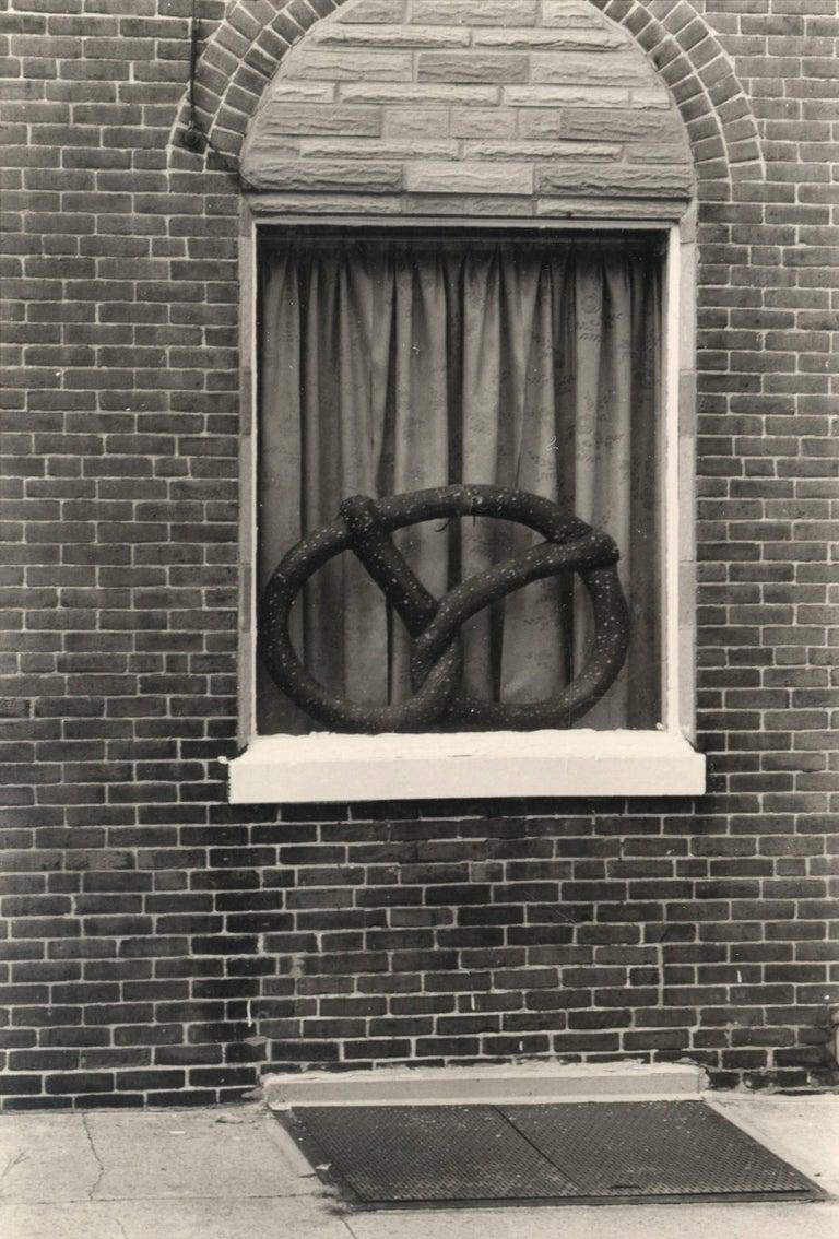 Will Brown Black and White Photograph - Pretzel Window (Philadelphia)