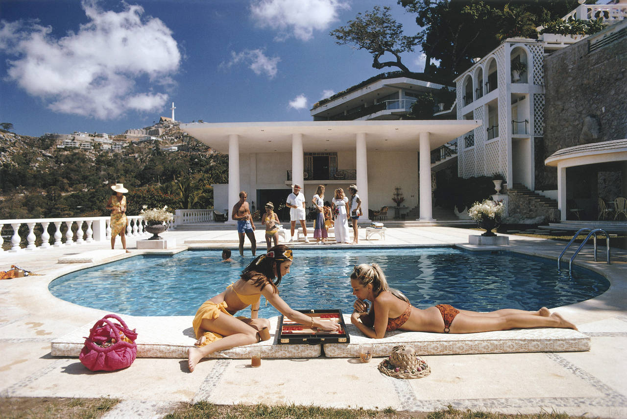 Slim Aarons Color Photograph - Poolside Backgammon (Aarons Estate Edition)