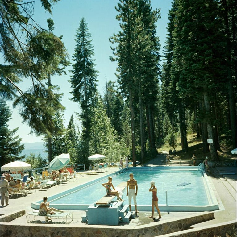 Bathers by a pool on the shore of Lake Tahoe, California, 1959.   Estate stamped and hand numbered edition of 150 with certificate of authenticity from the estate.   Slim Aarons (1916-2006) worked mainly for society publications photographing