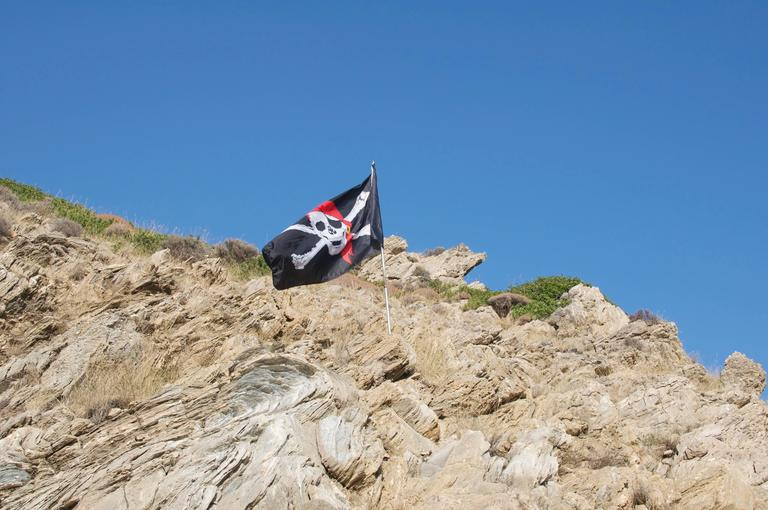 Leandros Pigades Color Photograph - Pirate Flag on Hillside