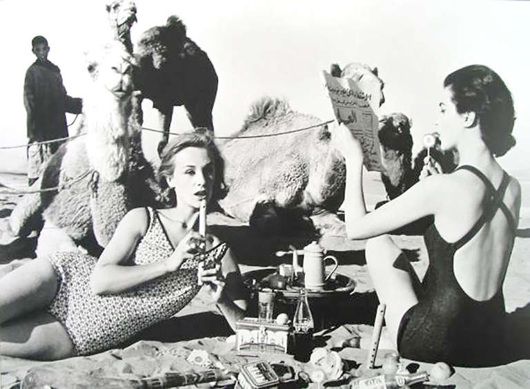 William Klein Figurative Photograph - Tatiana, Mary Rose and Camels, Picnic, Morocco, 1958