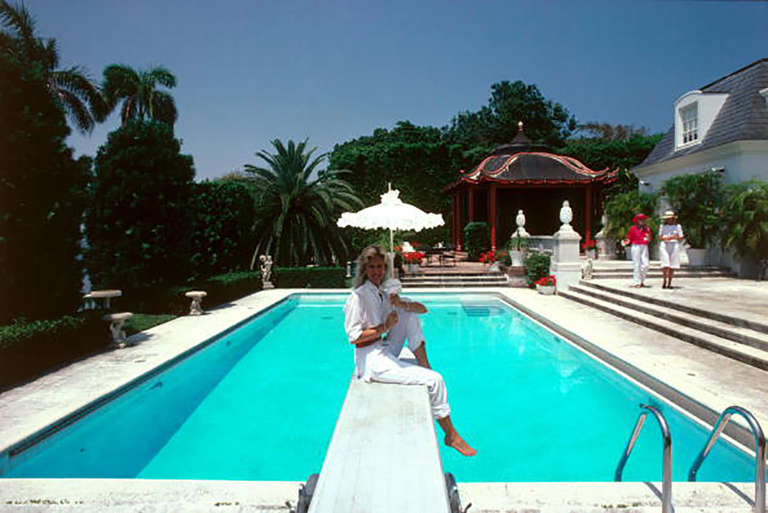 Slim aarons pool and parasol photograph for sale at 1stdibs - Palm beach swimming pool ...