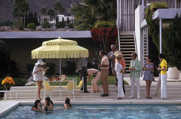 Slim Aarons Color Photograph - Poolside Party (Aarons Estate Edition)