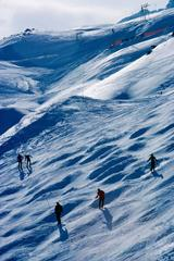 Skiers on a slope in St Moritz, Switzerland