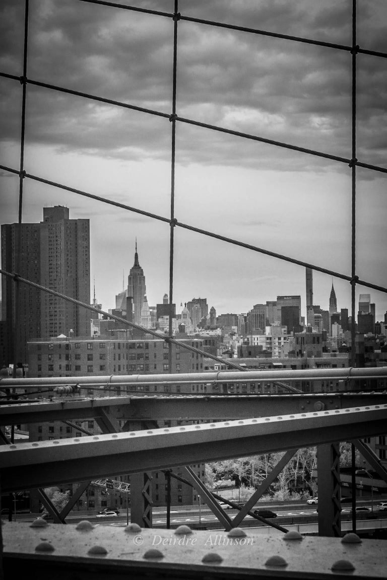 Deirdre Allinson Black and White Photograph - Framed. (New York Skyline Through Brooklyn Bridge Cables