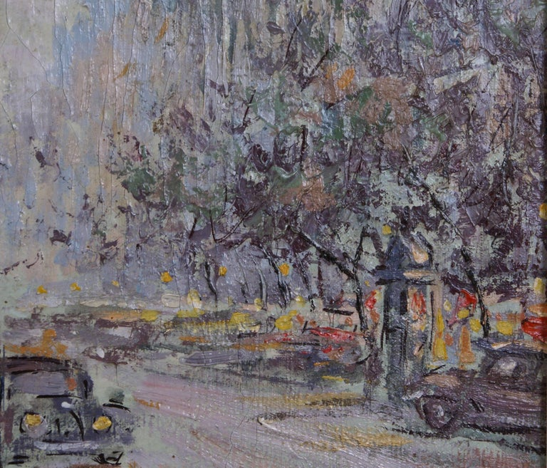 A lively intersection of Paris streets, possibly along the Rue de la Paix.  The colors of the flowers in the center are rich and colorful reflected in the expressed use of thicker paint, standing out against the grey overtones of the buildings in
