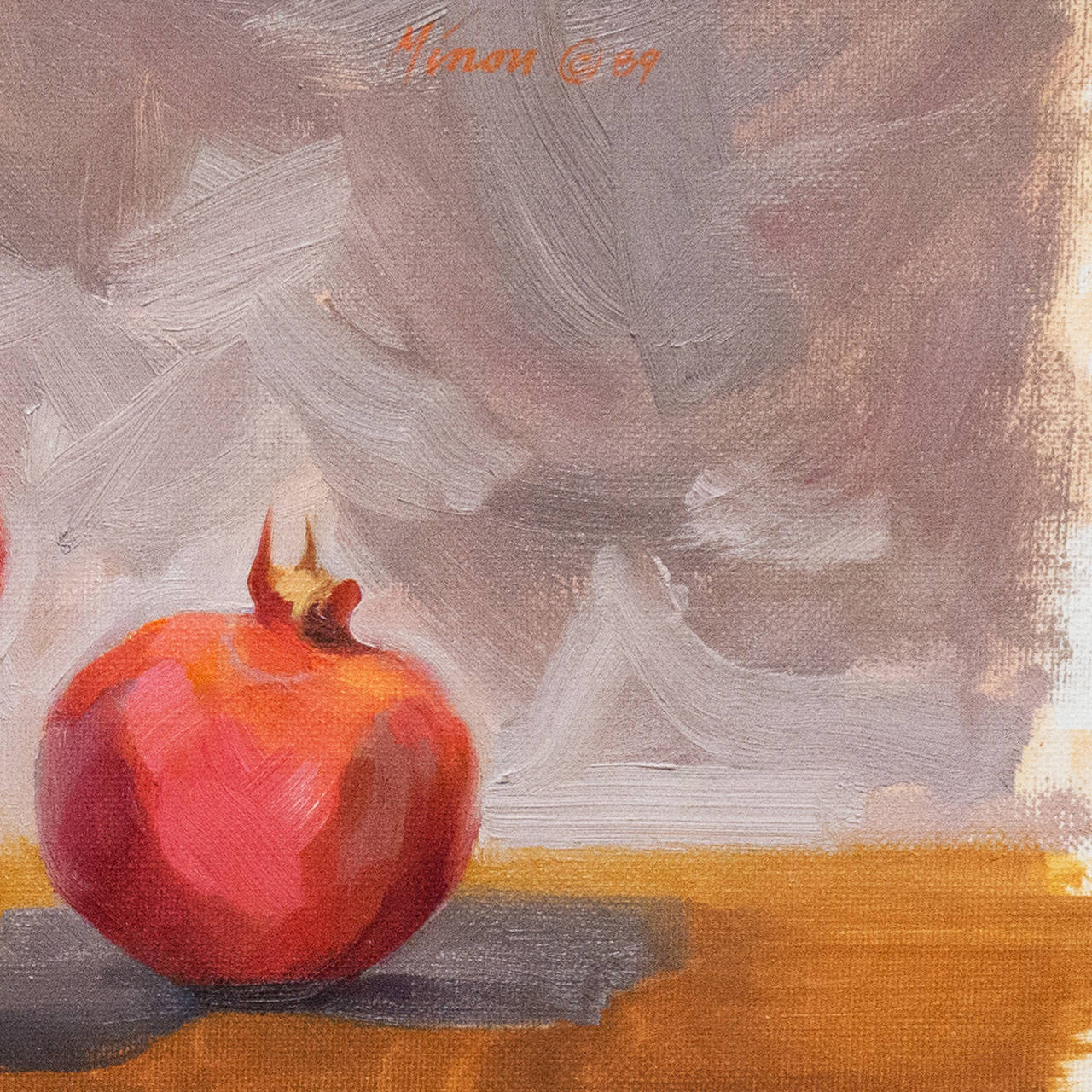 Signed upper right 'Minou' for Carole Minou (American, 1946-2012) and dated 1989.   An elegant oil still-life showing a view of three pomegranates and a child's wooden block arranged behind a delicate Navajo weaving.   A California native, Minou was