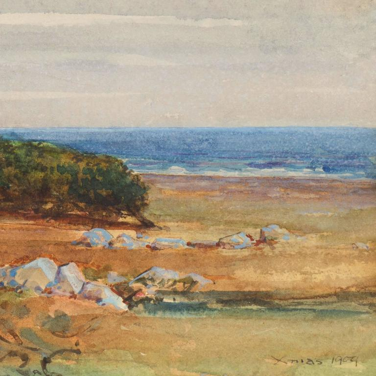An early-20th-century, landscape showing a view of the coastline at Moss Beach in Monterey County with slate-blue skies overhead and a view towards a stand of windswept Monterey Cypress with a view of the cobalt blue ocean beyond. A particularly