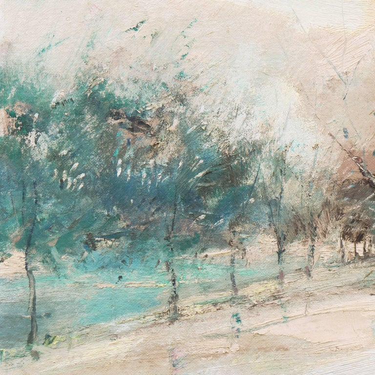 Oil landscape showing a view of Paris and the Seine in wintertime, with mauve and teal branches of bare trees contrasted against a background of ivory and blush with a view beyond towards a distant, snowy bridge crossing the river.   Signed lower