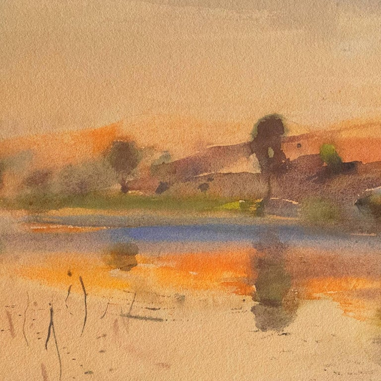 Signed lower left, 'Karl Yens' and painted circa 1920. Excellent condition with fresh unfaded colors.  A fine, early 20th century wartercolor landscape showing the the luminous sunset serenely reflected in a still lake with elegant, calligraphic