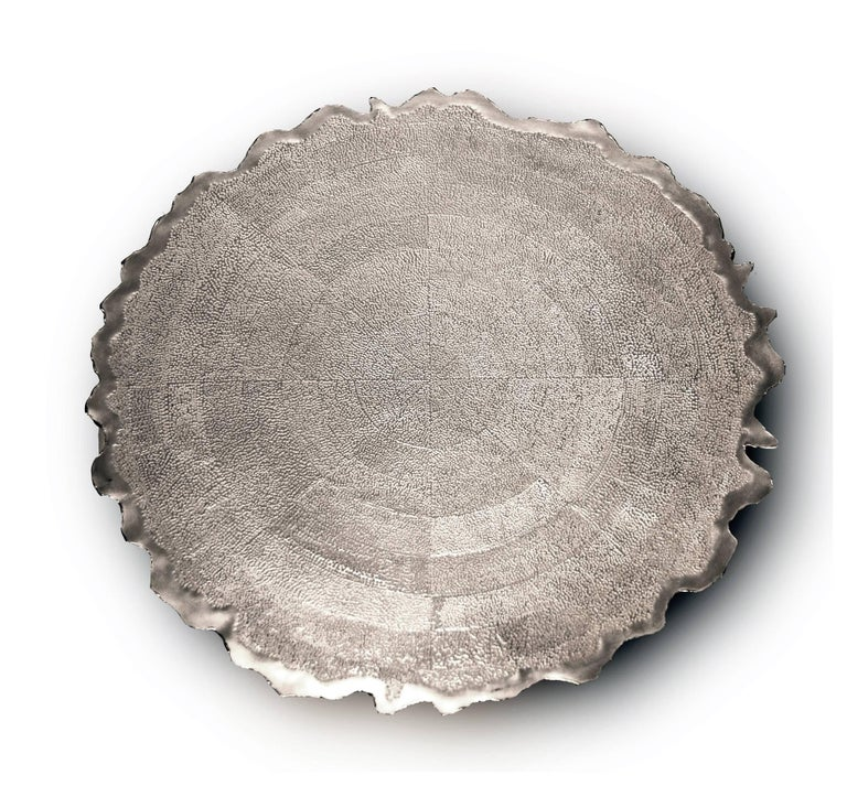 This beautiful piece was inspired by the artisan traditions and tropical nature of the Pacific and Caribbean regions of Colombia. It was designed and sculpted by renowned Colombian silversmith Alexandra Agudelo. Agudelo creates an ideal harmony in