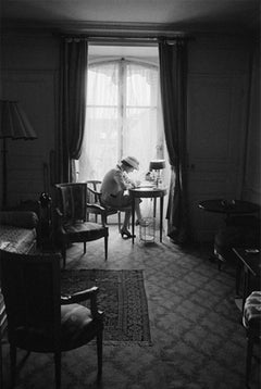 Coco Chanel Writes At Her Desk, Head Down