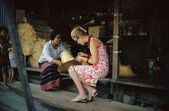 Tiger Morse Examines a Straw Hat, Bangkok, 1962