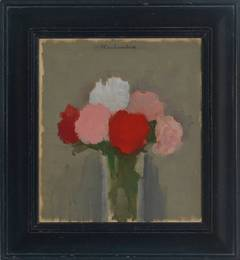 Red, Pink, and White Flowers in a Glass Vase against a Grey Background