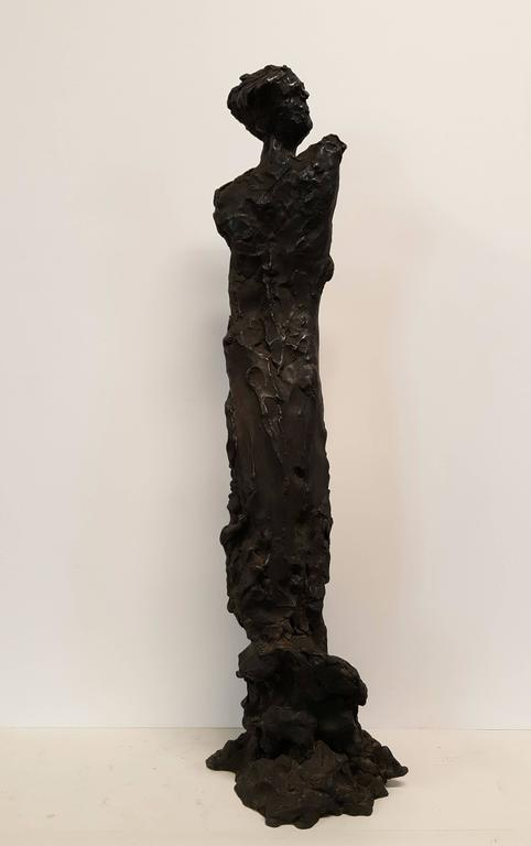 JONATHAN SILVER (1937-1992) Standing Woman, 1991 Bronze with dark brown patina 23 x 7 x 6 ½ inches Signed, dated, and numbered at base: J. Silver 91 / 2/6 From an edition of six  PROVENANCE  Victoria Munroe Gallery, New York, New