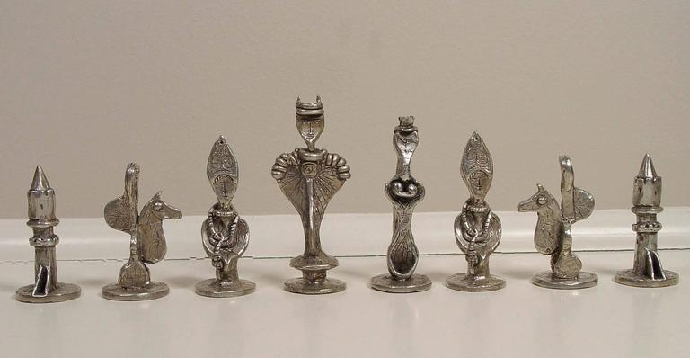 DOROTHY DEHNER (1901-1994) Chess Set, 1957 conceived, cast in 1993-4 Pewter Height: 2 - 4 inches Signed and numbered From an edition of 25  Dorothy Dehner was born in Cleveland, Ohio, but moved to Pasadena, California in 1916 after the death