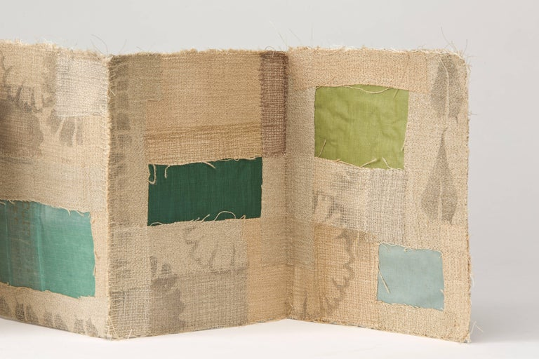 Reclaimed linen, bookcloth from discarded library books, stencils, thread, mull, and custom made clamshell box.