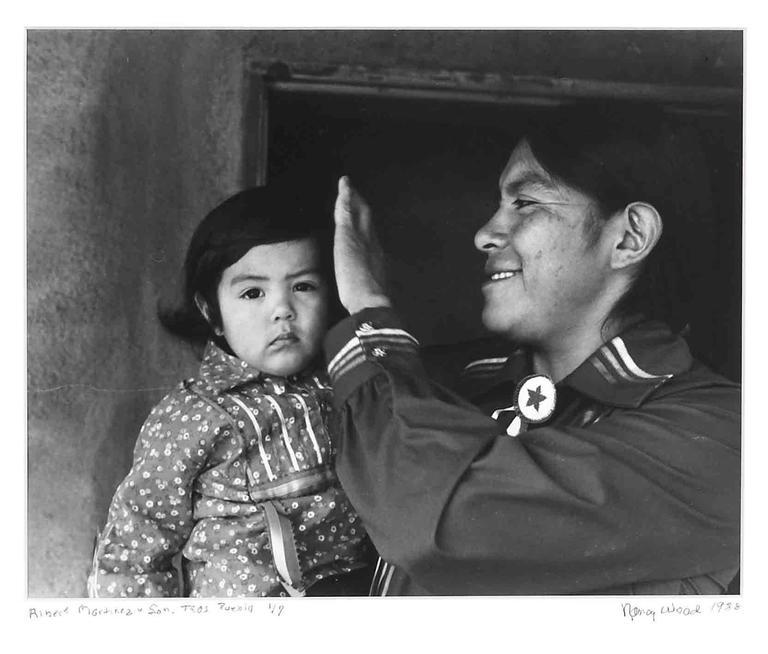 Nancy Wood Black and White Photograph - Albert Martinez and son - Taos Pueblo 1/7, 1988